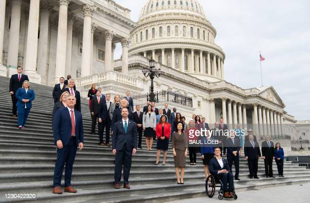 House Minority Leader Kevin McCarthy , Republican of California, stands alongside newly-sworn in first-term Republican members of Congress on the...