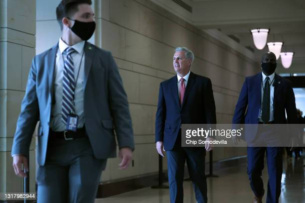 House Minority Leader Kevin McCarthy returns to his office following a House Republican caucus meeting in the U.S. Capitol Visitors Center on May 14,...