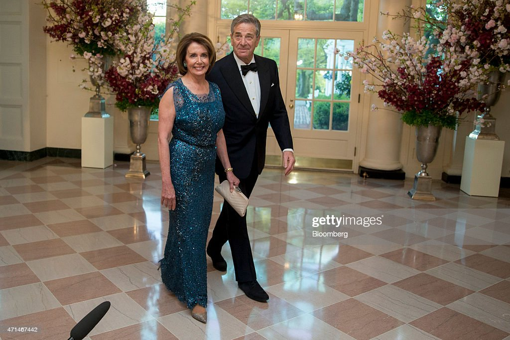 House Minority Leader Nancy Pelosi, a Democrat from California, left, and Paul Pelosi arrive at a state dinner hosted by U.S. President Barack Obama and U.S. First Lady Michelle Obama in honor of Japan's Prime Minister Shinzo Abe at the White House in Washington, D.C., U.S., on Tuesday, April 28, 2015. Prime Minister Shinzo Abe goes before the U.S. Congress on Wednesday to present Japan as a stalwart ally that's willing to play a bigger military role in Asia, a message likely to be embraced in Washington and greeted with suspicion in Seoul and Beijing. Photographer: Andrew Harrer/Bloomberg via Getty Images