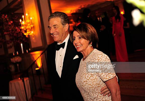 House Minority Leader Nancy Pelosi a Democrat from California right and husband Paul Pelosi attend the Bloomberg Vanity Fair White House...