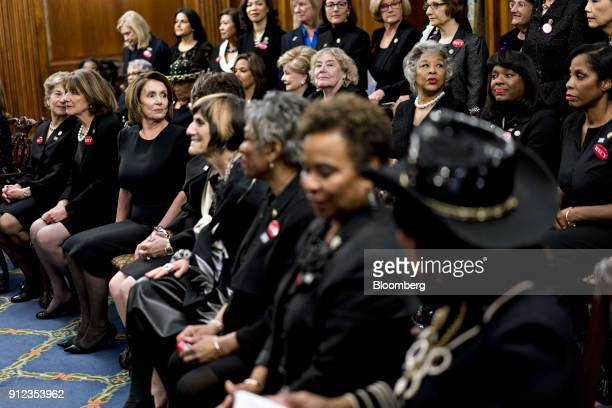 House Minority Leader Nancy Pelosi a Democrat from California second left sits for a photograph with members of Congress while wearing black in...