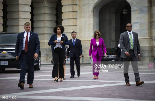 House Minority Leader Nancy Pelosi a Democrat from California second right arrives to a news conference on the longterm effects of separating...