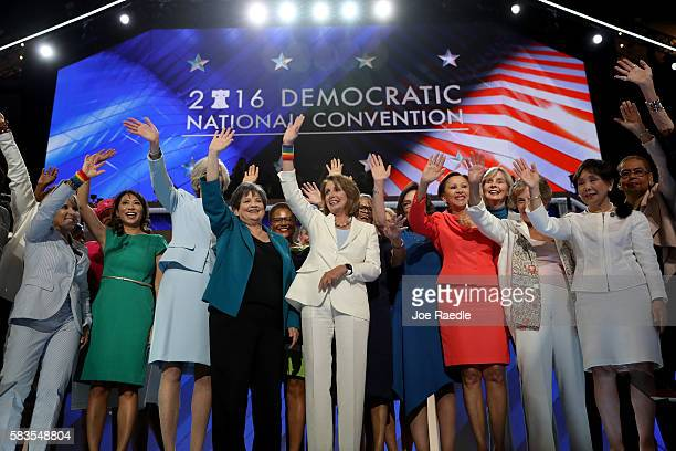House Minority Leader Nancy Pelosi along with other Democratic women members of the House of Representatives wave to the crowd after delivering...