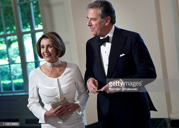 House Minority Leader Nancy Pelosi and her husband Paul Pelosi arrive at the White House June 7 2011 in Washington DC Guests arrived to attend a...