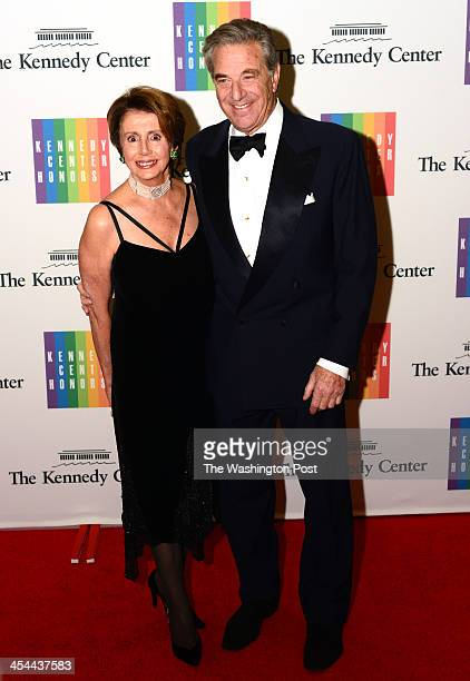 House minority leader Nancy Pelosi and husband Paul arrive at a special dinner for Kennedy Center honorees and guests at the State Department in...