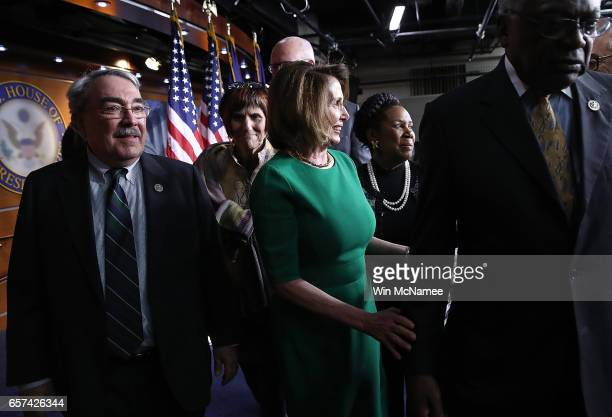 House Minority Leader Nancy Pelosi and members of the House Democratic caucus depart after US Speaker of the House Paul Ryan pulled President Trump's...