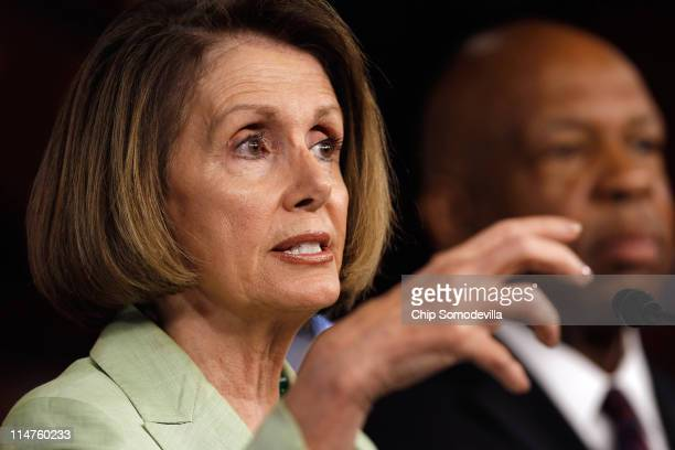 House Minority Leader Nancy Pelosi and Rep Elijah Cummings hold a news conference at the US Capitol May 26 2011 in Washington DC During her weekly...