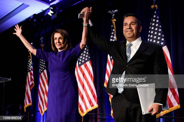 TOPSHOT House Minority Leader Nancy Pelosi and Representative Ben Ray Lujan DCCC Chairman celebrate a projected Democratic Party takeover of the...