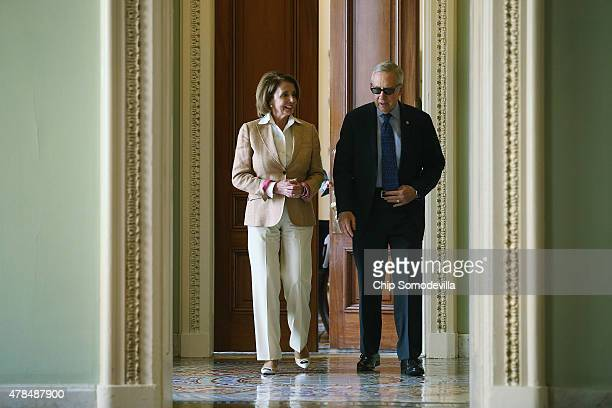 House Minority Leader Nancy Pelosi and Senate Minority Leader Harry Reid leave his office on their way to a a news conference at the U.S. Capitol...