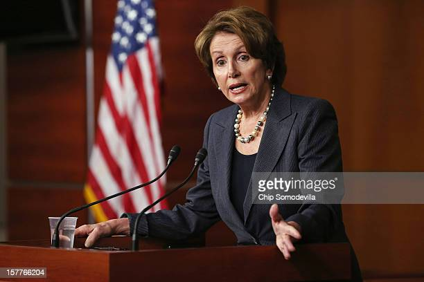 House Minority Leader Nancy Pelosi answers reporters' questions during her weekly news conference at the US Capitol Visitors Center December 6 2012...