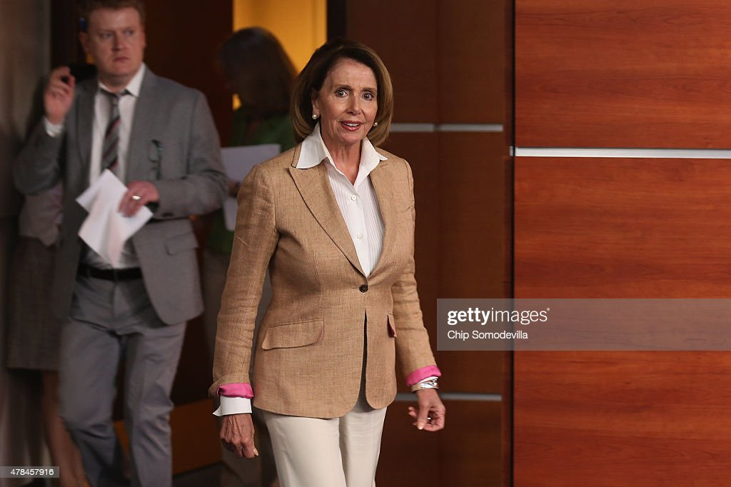 House Minority Leader Nancy Pelosi (D-CA) arrives for her weekly news conference at the U.S. Capitol June 25, 2015 in Washington, DC. Pelosi said she was jubilant after the Supreme Court handed down a 6-3 decision that the Affordable Care Act authorized federal tax credits for eligible Americans living not only in states with their own exchanges but also in the 34 states with federal exchanges, a major victory for Democrats and President Barack Obama.