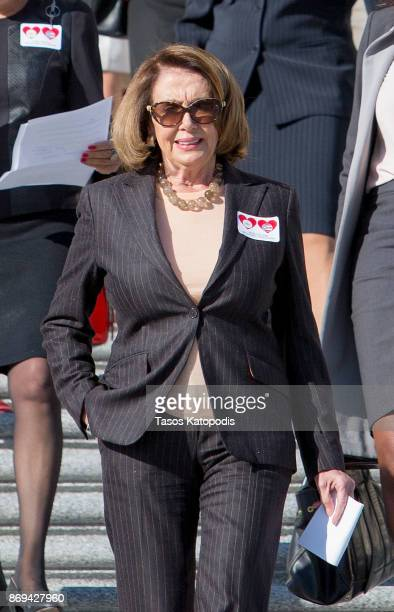 House Minority Leader Nancy Pelosi attends a press conference to show solidarity with the people of Puerto Rico and US Virgin Islands after the...