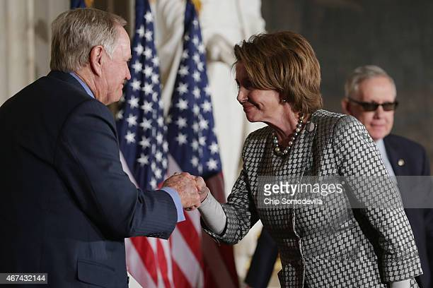 House Minority Leader Nancy Pelosi congratulates Golf legend Jack Nicklaus during his the Congressional Gold Medal deremony in the US Capitol Rotunda...