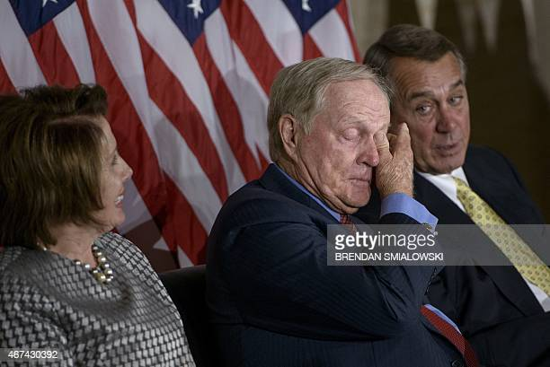 House Minority Leader Nancy Pelosi DCA and Speaker of the House John Boehner ROH watch as Jack Nicklaus wipes a tear during a Congressional Gold...