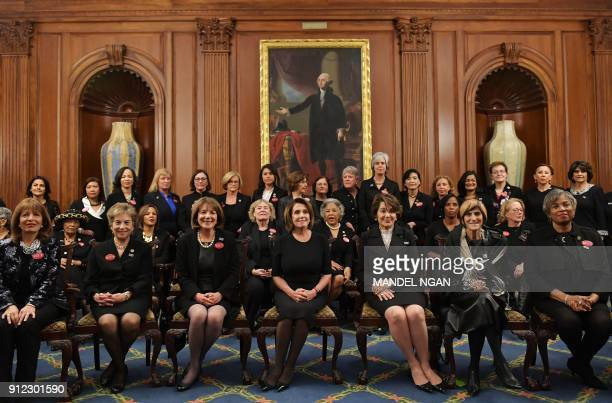 House Minority Leader Nancy Pelosi DCA poses with members of Congress wearing black in support of the metoo movement in the Rayburn Room of the US...