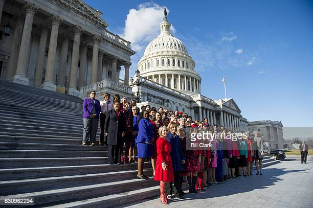 House Minority Leader Nancy Pelosi DCalif and the other Democratic women pose on the House steps on Wednesday Jan 4 to highlight the historic...