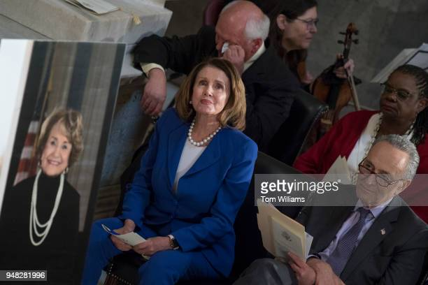 House Minority Leader Nancy Pelosi DCalif center Senate Minority Leader Charles Schumer DNY right Reps Gwen Moore DWis and Paul Tonko DNY listen to...