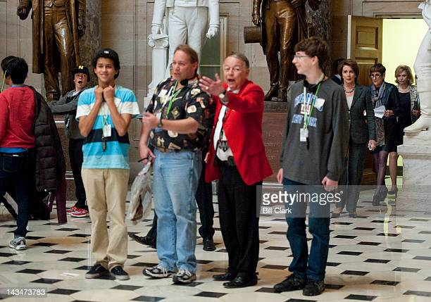 House Minority Leader Nancy Pelosi DCalif followed by Reps Rosa DeLauro DConn and Carolyn Maloney DNY walk through Statuary Hall on their way to...