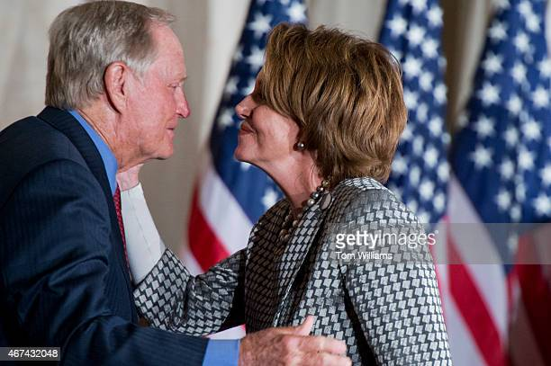 House Minority Leader Nancy Pelosi DCalif greets golf legend Jack Nicklaus during a Congressional Gold Medal in the Capitol's rotunda at which...