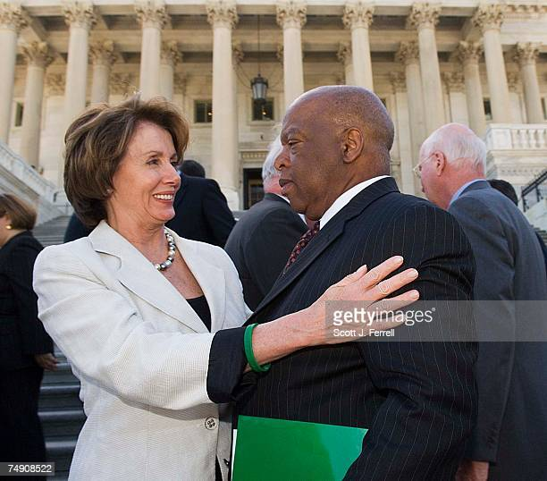House Minority Leader Nancy Pelosi DCalif hugs Rep John Lewis DGa after a show of unity in support of the bipartisan bicameral extension of expiring...