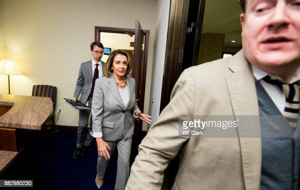 House Minority Leader Nancy Pelosi DCalif leaves her weekly on camera news conference in the Capitol on Thursday Nov 30 after calling on Rep John...