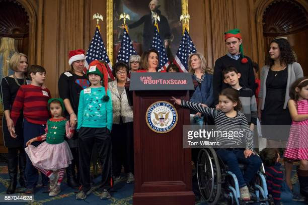 House Minority Leader Nancy Pelosi DCalif MomsRising and other members conduct a news conference in the Capitol on December 6 to say the Republican...