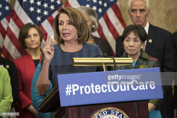 House Minority Leader Nancy Pelosi flanked by House Democrats speaks about the Affordable Care Act on Capitol Hill January 12 2017 in Washington DC...