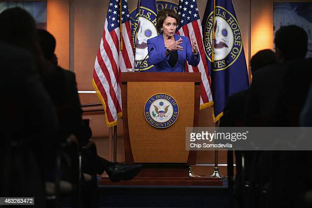 House Minority Leader Nancy Pelosi holds her weekly news conference in the Capitol Visitors Center at the US Capitol February 12 2015 in Washington...