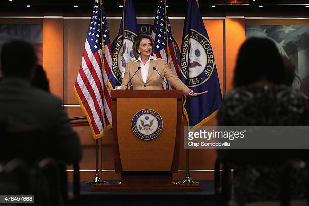 House Minority Leader Nancy Pelosi holds her weekly news conference at the US Capitol June 25 2015 in Washington DC Pelosi said she was jubilant...