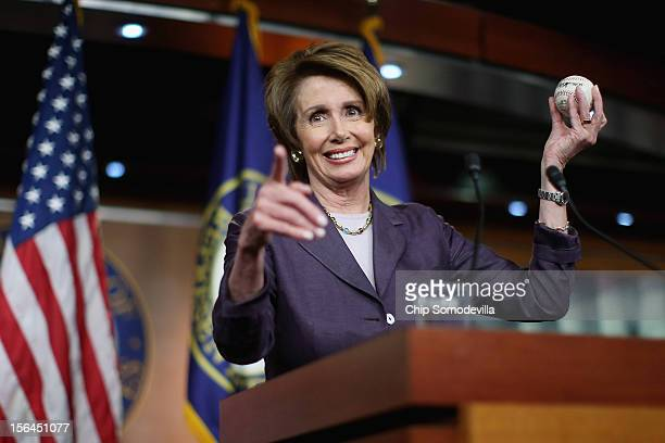 House Minority Leader Nancy Pelosi holds up a World Series baseball autographed by San Francisco Giants players from the past and present during her...