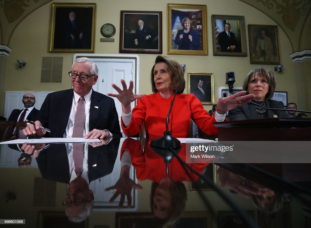 House Minority Leader, Nancy Pelosi (D-CA), (C), House Minority Whip, Steny Hoyer (D-MD), and Rep. Michelle Lynn Lujan Grisham (D-NM) (R), participate in a House Rules Committee meeting as negotiations continue on funding the government to avert a shutdown at midnight on Friday night, at the U.S. Capitol on December 21, 2017 in Washington, DC.
