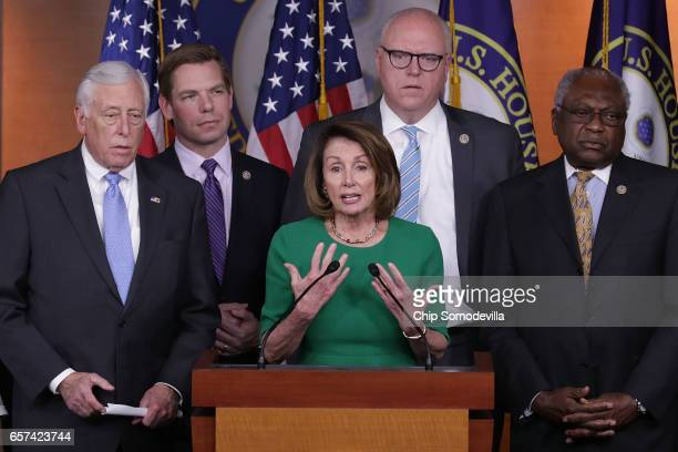 House Minority Leader Nancy Pelosi is joined by House Minority Whip Steny Hoyer Rep Eric Swalwell Rep Joe Crowley and Rep James Clyburn for a news...