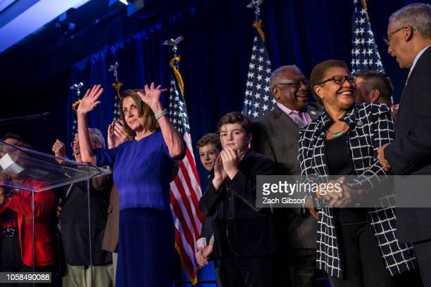 House Minority Leader Nancy Pelosi joined by House Democrats leaves the podium after delivering remarks during a DCCC election watch party at the...