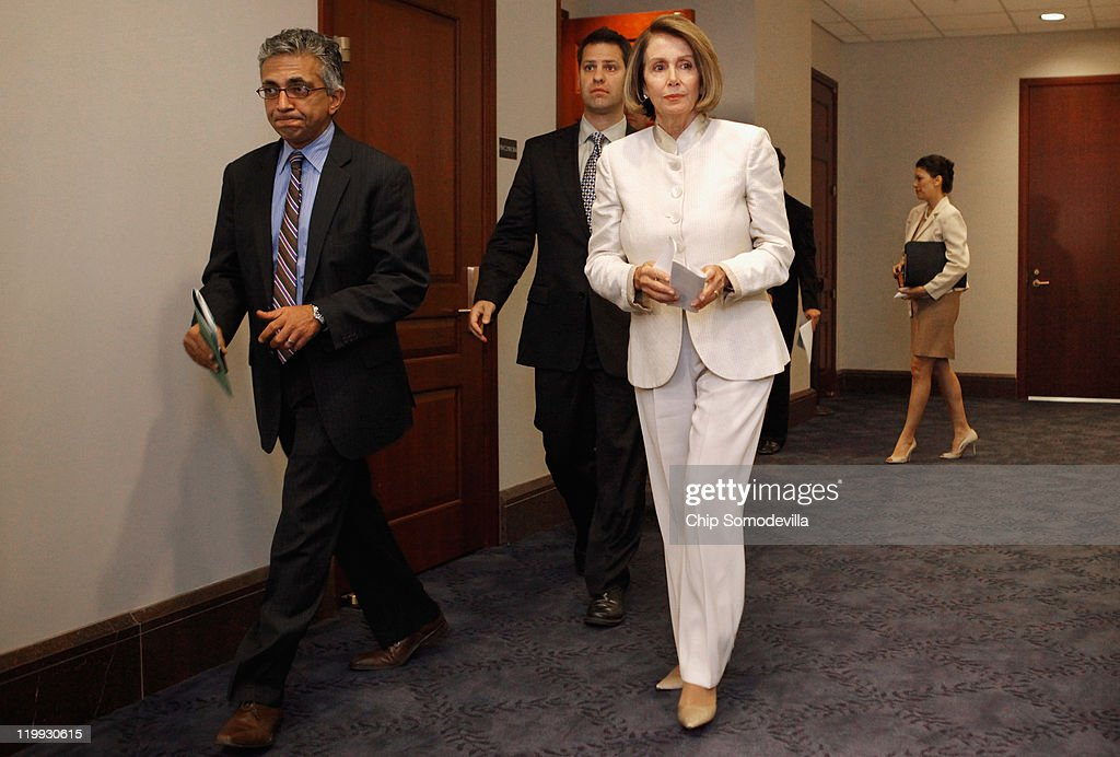 House Minority Leader Nancy Pelosi (D-CA) (C) leaves a House Democratic caucus meeting in the U.S. Capitol Visitors Center July 27, 2011 in Washington, DC. Democrats and Republicans continue to meet separately to discuss strategy as the deadline for the federal debt ceiling looms and negotiations between Congress and the White House falter.