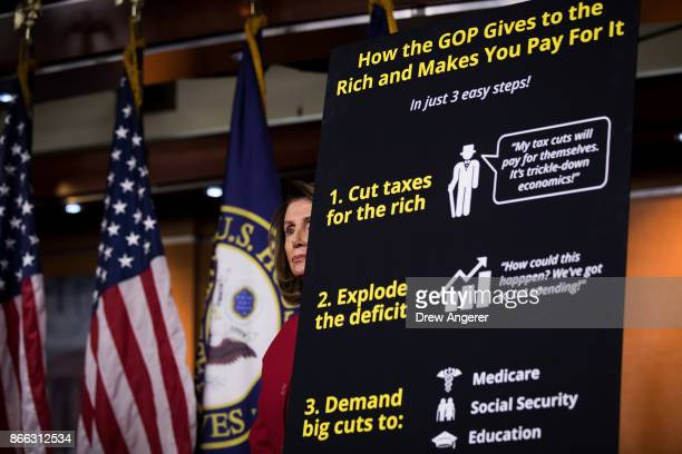 House Minority Leader Nancy Pelosi looks on during a news conference to express their opposition to the GOP tax reform plan October 25 2017 in...