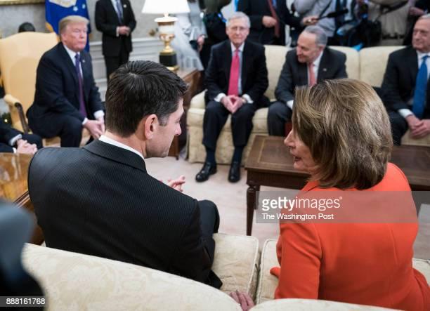 House Minority Leader Nancy Pelosi of Calif and House Speaker Paul Ryan of Wis speak as President Donald Trump accompanied by Vice President Mike...