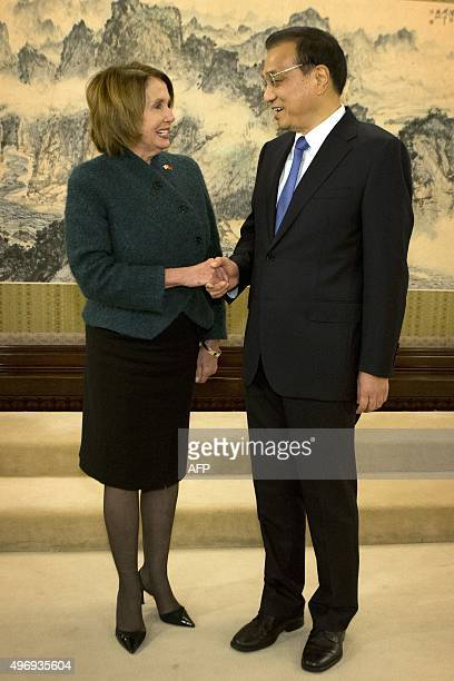 US House Minority Leader Nancy Pelosi of California shakes hands with Chinese Premier Li Keqiang as she arrives for a bilateral meeting at the...