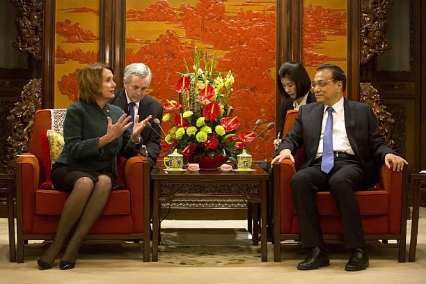 House Minority Leader Nancy Pelosi of California speaks with Chinese Premier Li Keqiang during a bilateral meeting at the Zhongnanhai leadership...