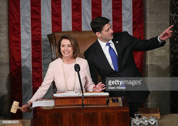 House Minority Leader Nancy Pelosi prepares to hand the Speakers gavel to newly elected House Speaker Paul Ryan in the House Chamber January 3 2017...