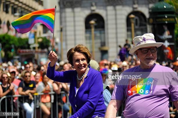 House Minority Leader Nancy Pelosi rides in a car as it travels along the parade route at San Francisco's Gay Pride festival in California on Sunday...