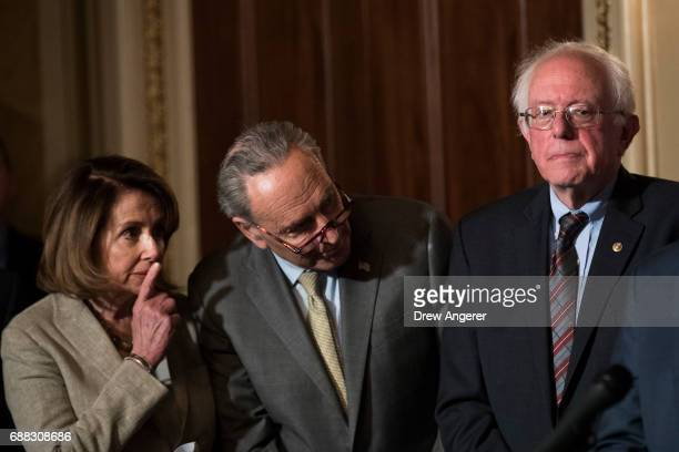 House Minority Leader Nancy Pelosi Senate Minority Leader Chuck Schumer and Sen Bernie Sanders confer during a press conference to discuss...