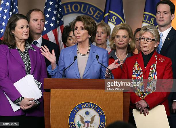House Minority Leader Nancy Pelosi speaks about high capacity magazines while flanked by Rep Carolyn McCarthy Rep Diana DeGette and other members of...