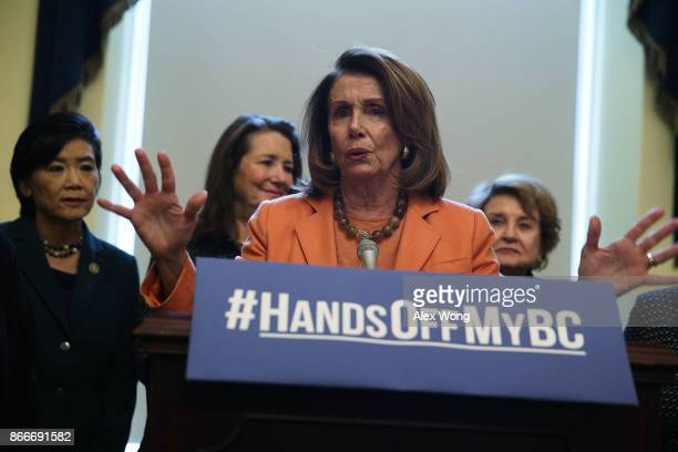 S House Minority Leader Nancy Pelosi speaks as Rep Judy Chu Rep Diana DeGette and Rep Louise Slaughter listen during a news conference October 26...