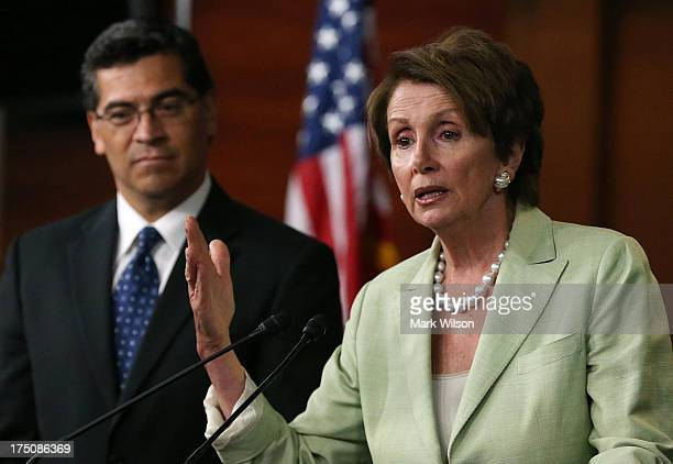 House Minority Leader Nancy Pelosi speaks to the media with Rep Xavier Becerra after a meeting with President Barack Obama on Capitol Hill July 31...