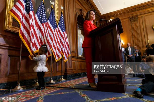 House Minority Leader Nancy Pelosi speaks with journalists' kids during her weekly press conference on 'Take our Daughters and Sons to Work Day' at...