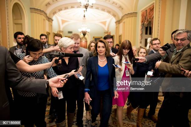 House Minority Leader Nancy Pelosi speaks with reporters as she makes her way to Senate Minority Leader Chuck Schumer's office at the US Capitol...