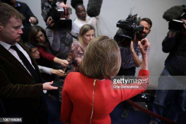 House Minority Leader Nancy Pelosi talks to journalists before heading into a Democratic caucus meeting in the US Capitol Visitors Center November 14...