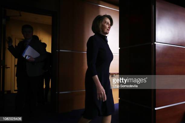 House Minority Leader Nancy Pelosi talks to reporters during her weekly news conference at the US Capitol Visitors Center December 13 2018 in...