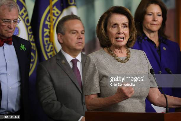 House Minority Leader Nancy Pelosi talks to reporters while announcing the House Democrats' new infrastructure plan during a news conference with Rep...