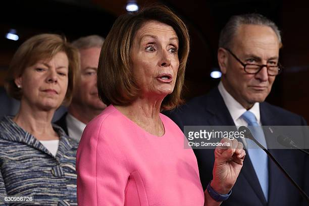 House Minority Leader Nancy Pelosi talks to reporters with fellow Democrats from both the House and Senate including Sen Tammy Baldwin and Senate...